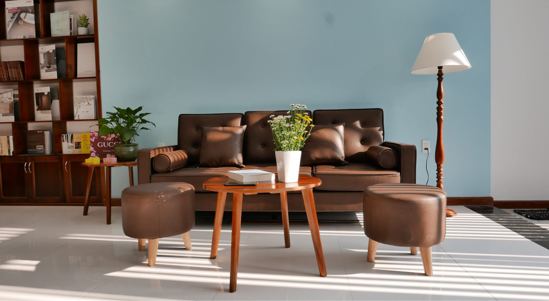 Leather sofa against blue wall