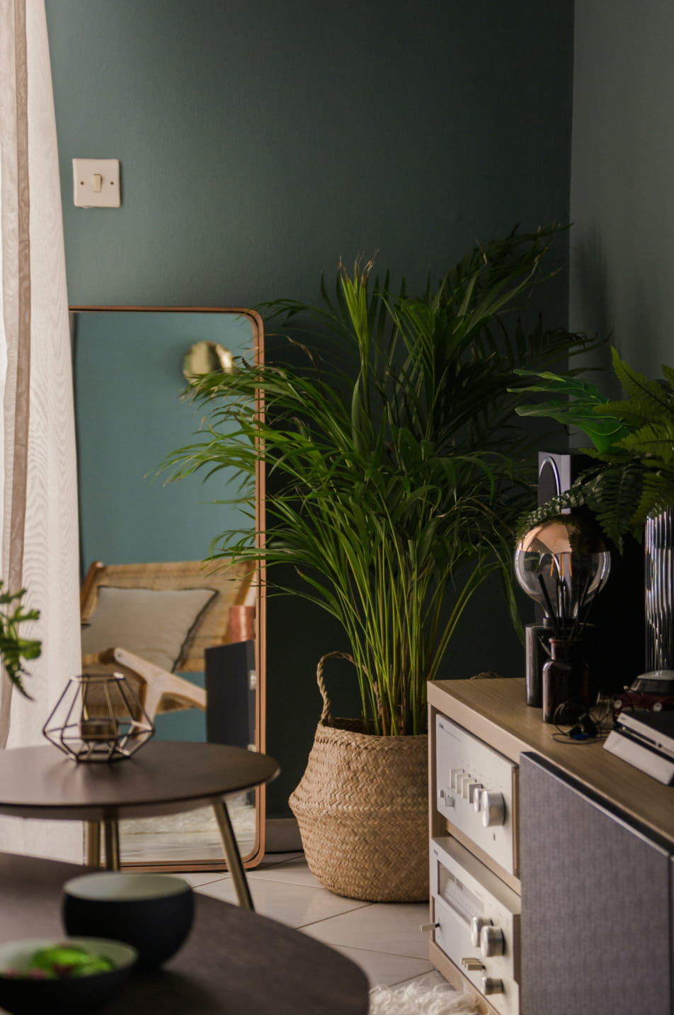 Room corner with mirror and plant